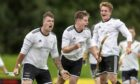 Lovat players celebrate their second goal scored by Marc MacLachlan (left).