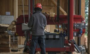 A member of staff at work at the sawmill.