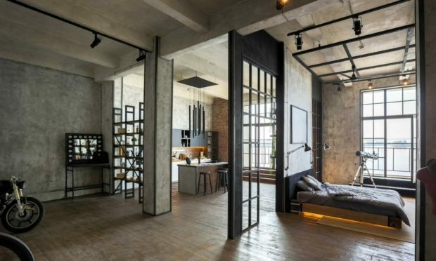 Exposed brick and flooring are features of the industrial style reminiscent of a New York loft.