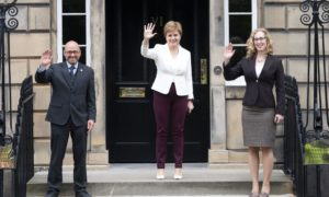 First Minister Nicola Sturgeon (centre) with Scottish Green co-leaders Patrick Harvie and Lorna Slater.