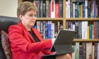 First Minister Nicola Sturgeon at her home in Glasgow preparing her speech for the SNP National Conference (Photo: PA)