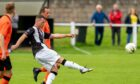 Wick's Gordon MacNab has a shot at goal against Rothes