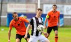 Wick's Steven Anderson, right, tries to hold off Rothes' Michael Finnis