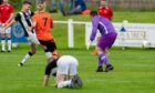 Joe Anderson, on the ground, as Rothes score against Wick on his first start for Academy