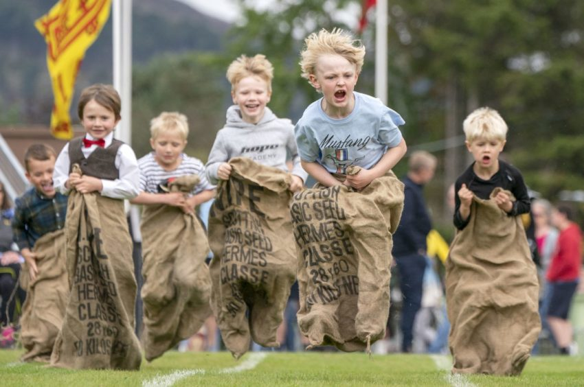 Youngsters take part in the Sack Race Photo: Jane Barlow/PA Wire