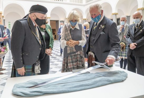 The Duke and Duchess of Rothesay are presented with a replica of the sword of Robert the Bruce during a visit to the redeveloped Aberdeen Art Gallery. Picture by PA.