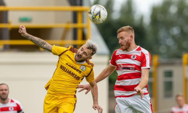 Paul Brindle of Forres, left, and Bonnyrigg's Dean Hoskins compete for the ball