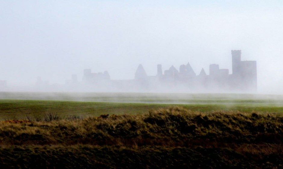 Slains Castle is a ghostly site in the haar.