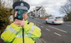 A life size cut out of a Police officer with a speed camera to help curb speeding has been stolen from a Caithness village.