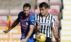 Kirk Broadfoot in action against Dunfermline's Nikolay Todorov.