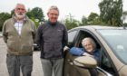 Left to right: Paul Stallard, Colin Spence and Gladys Cruickshank, volunteers with the Alford Car Transport Service.  Picture by Wullie Marr