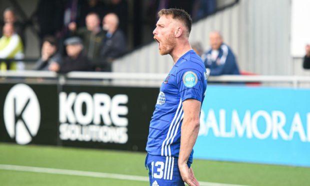 Cove Rangers forward Rory McAllister celebrates opening the scoring.