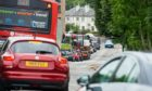 The works have caused delays of up to 30 minutes on Muggiemoss Road. Photo: Wullie Marr/DCT Media