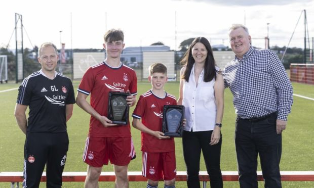 l-r AFC Youth Academy director Gavin Levey, talent of the month Alfie Bavidge, young talent of the month Rory Phillips, Amplus HR adviser Ali Herd and Amplus managing director Ian Herd.