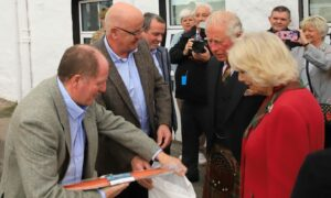 Charles and Camilla came away from Portree with some locally produced organic salmon.