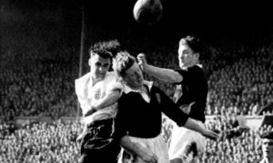 A link between former players and head injuries has been proven. Picture shows England's Stan Pearson and Scotland's Bobby Evans and George Young.
