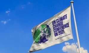 A flag with a picture of earth on it alongside text relating to COP26 Glasgow
