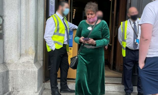 Dee Buchanan leaving court.