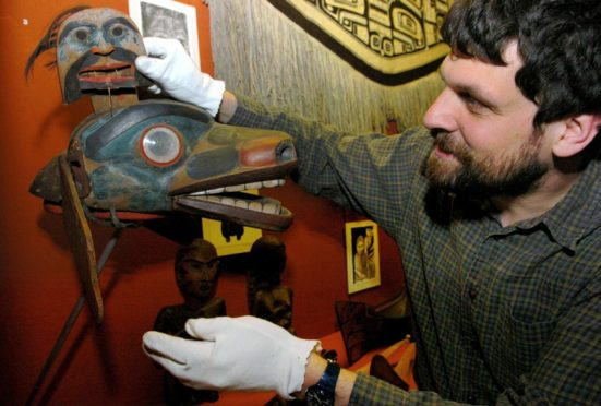 Senior curator at the Marischal Museum Neil Curtis, pictured in 2004, with an eighteenth Century animal mask.