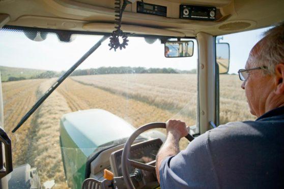A farmer working. Farmers stress and fatigue aberdeen