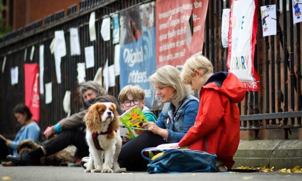 Protestors took part in a library read-in to save Whiteinch Library in Glasgow earlier this year (Photo: Ewan Bootman/NurPhoto/Shutterstock)