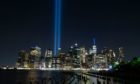 The Towers of Light Memorial illuminating the New York City skyline with The Freedom Tower on The 20th anniversary of The 9/11 attacks (Photo: Kostas Lymperopoulos/CSM/Shutterstock)