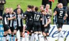 Elgin City players celebrate netting against Caley Thistle.