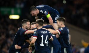 Scotland's Scott McTominay celebrates with teammates after scoring to make it 3-2 during a FIFA World Cup Qualifier between Scotland and Israel at Hampden Park. Photo by Craig Foy/SNS Group
