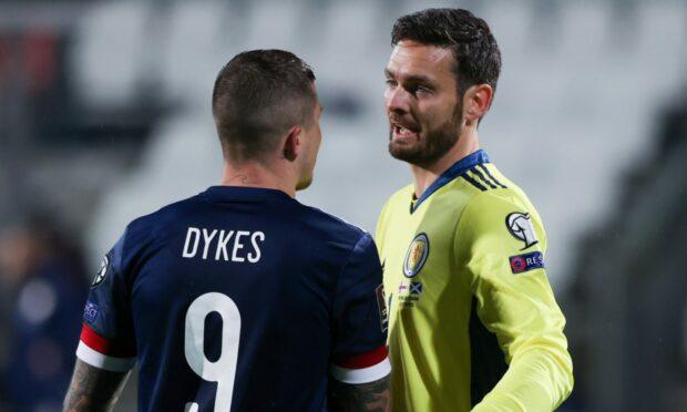 Scotland goalkeeper Craig Gordon with match-winner Lyndon Dykes.