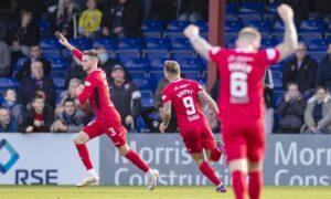 St Mirren's Scott Tanser makes it 3-1 following a Ross County defensive mix-up.