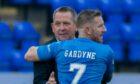 Caley Jags head coach Billy Dodds congratulates second goalscorer Michael Gardyne at full-time.