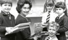 1982 - P1 and P2 pupils of Balmedie Primary School helping head teacher Lilian Youngson with books in the new library are, from left, Steven Masson, Marissa Carrara, Rodney McKnight and Louise Stewart