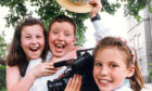 1992 - Chloe Morrison, left, and James Bell, both 8, are captured in happy mood by Katie Hurman after the school won first prize in the annual Scottish Young Persons Video competition