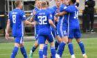 Peterhead players celebrate Niah Payne's opening goal.