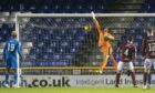 Inverness goalkeeper Mark Ridgers fails to deal with a wide free-kick from Arbroath's Michael McKenna which flies into the net for a 1-0 lead.