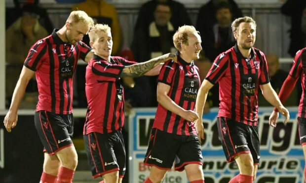 Inverurie players celebrate their second goal in the Aberdeenshire Shield tie against Fraserburgh