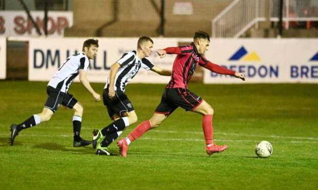 Kieran Shanks, right, looks to get a shot away for Inverurie against Fraserburgh