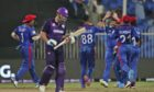 Afghanistan players celebrate the dismissal of Scotland batter George Munsey.
