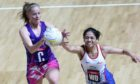 Scotland's Claire Maxwell (left) and Samoa's Soli Ropati battle for the ball during the Netball World Cup match at the M&S Bank Arena, Liverpool.