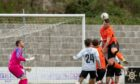 Ryan McRitchie attempts to force the ball into the net for Rothes against Brora Rangers in the North of Scotland Cup final