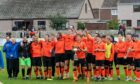The Rothes squad celebrate winning the North of Scotland Cup final