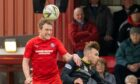 Ally MacDonald, left, in action for Brora Rangers against Albion Rovers in the Scottish Cup second round tie at Dudgeon Park.