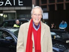 Nicholas Parsons revealed he was absent from Just A Minute because he had flu (Phil Toscano/PA)