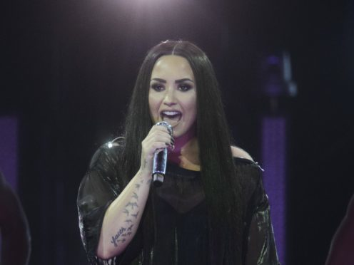 Clean Bandit and Demi Lovato are vying for the chart top spot (John Linton/PA)