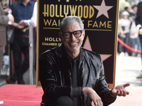 Actor Jeff Goldblum, best known for his roles in Independence Day and Jurassic Park, poses atop his star on the Hollywood Walk of Fame (Chris Pizzello/Invision/AP)