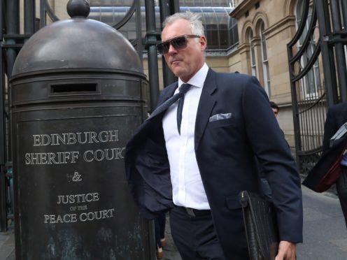 Former TV presenter John Leslie leaves Edinburgh Sheriff Court (Andrew Milligan/PA)