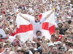 England supporters and festival goers watch England v Panama (David Jensen/PA)