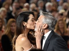 George Clooney gets a kiss from his wife Amal as he arrives for the 46th AFI Life Achievement Award (Chris Pizzello/Invision/AP)