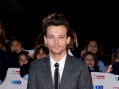 Louis Tomlinson is reportedly set to become a judge on X Factor (Ian West/PA)
