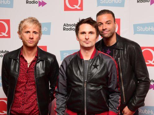 Dominic Howard, Matt Bellamy and Chris Wolstenholme of Muse (Ian West/PA)